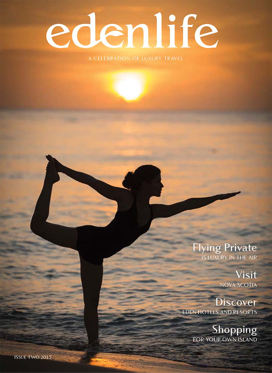 Cover for travel magazine of yoga on the beach in the Caribbean