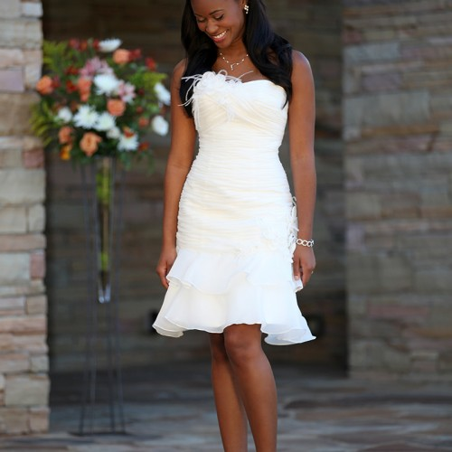 Black bride standing laughing