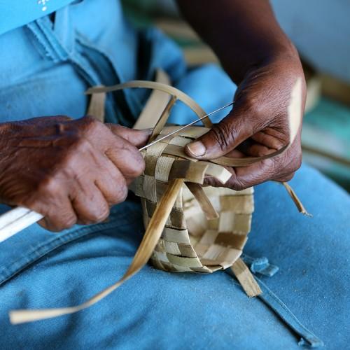 making baskets in market